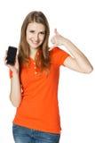 显示移动电话做的微笑的妇女告诉我姿态 免版税库存照片