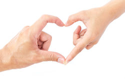 做心脏的男性和女性手塑造恋人concep的标志 库存照片
