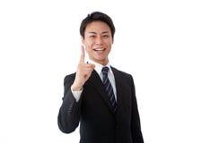 做手指的新生意人 免版税库存图片