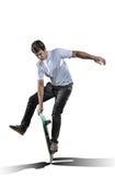 做把戏的溜冰板者被隔绝在白色 免版税库存图片