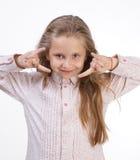 做摇滚乐标志的愉快的女孩 免版税库存图片