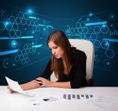 做文书工作有未来派背景的女实业家 库存照片