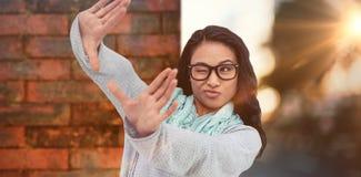 做正方形用手的亚裔妇女的综合图象 免版税库存照片