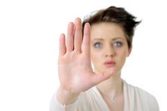 做照片终止妇女年轻人的姿态 免版税库存照片