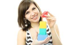 做玩具妇女年轻人的美丽的房子 库存照片