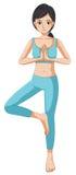 做瑜伽的一个美丽的女孩 免版税图库摄影