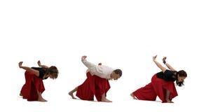 做瑜伽的人们行使在白色隔绝的射击 免版税库存照片