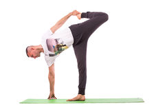做瑜伽的大力士 库存照片