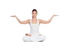 做瑜伽的美丽的妇女 库存图片