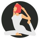 做瑜伽象的妇女 库存照片