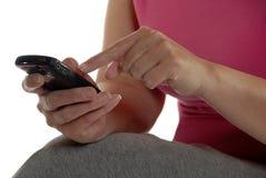 做电话妇女的购买权电池 库存图片