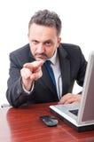 做的商人观看您打手势 库存图片
