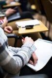 做笔记在教室 图库摄影