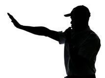做终止业务量的警察姿态 免版税图库摄影