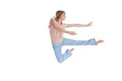 做舞蹈姿势的妇女 免版税库存照片