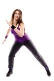 做舞蹈移动的年轻运动妇女 免版税库存图片