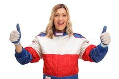做赞许姿态的女性赛车手 库存图片
