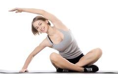 做边弯曲的锻炼的运动的妇女 库存图片