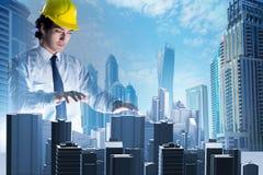 做都市计划的未来派建筑师 图库摄影