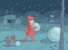做雪人的女孩和猫在晚上 库存图片