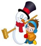 做雪人的男孩 图库摄影