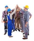 做高五的不同种族的小组工匠 库存图片