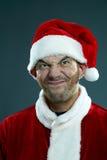 做鬼脸的圣诞老人 免版税库存照片