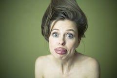 做鬼脸的妇女 免版税图库摄影