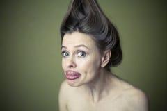 做鬼脸的妇女 免版税库存照片