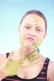 做鬼脸肮脏的青少年的女孩 库存照片