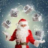 做魔术的圣诞老人 库存图片