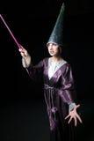 做魔术的美丽的妇女 图库摄影