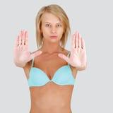 做终止妇女年轻人的姿态 图库摄影
