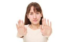 做终止妇女年轻人的姿态 免版税库存照片