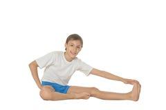 做锻炼的男孩 免版税库存照片