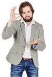 做他的手指小型的商人 情感,面部 库存照片