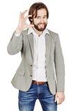 做他的手指小型的商人 情感,面部 免版税库存照片