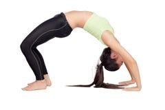 做pilates的妇女 免版税图库摄影