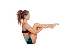 做pilates锻炼的可爱的妇女 库存图片