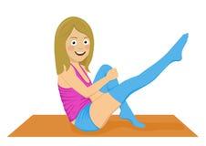 做pilates excercises的年轻人适合的妇女隔绝在白色背景 库存图片