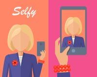 做Selfie的白肤金发的妇女 库存照片