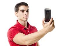做selfie画象的被隔绝的年轻人 图库摄影