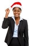 做wsih佩带的圣诞节帽子的非裔美国人的女实业家 免版税库存照片