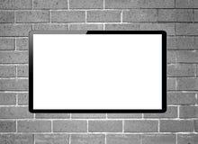 停止在墙壁上的黑屏LCD电视 免版税图库摄影