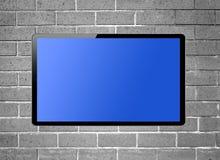 停止在墙壁上的黑屏LCD电视 图库摄影