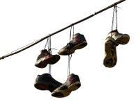 停止在电话线的运动鞋 免版税库存图片