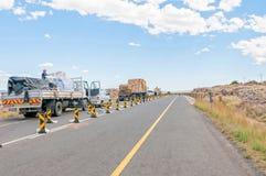 停止并且努力去做延迟在道路工程 免版税库存照片