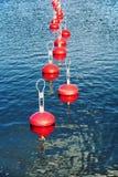 停泊的小船红色浮体在水 免版税库存照片