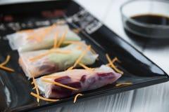 健康与菜、鱼和米线的快餐亚洲春卷 免版税图库摄影