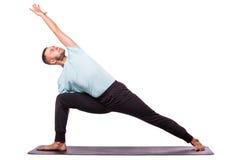 年轻健康人做在白色背景的瑜伽 免版税库存图片